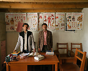 Two teachers. The small school  funded by the Aga Khan Foundation. <br /> The traditional life of the Wakhi people, in the Wakhan corridor, amongst the Pamir mountains.
