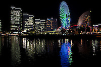 """Minato Mirai or """"future harbor"""" is Yokohama's showpiece along with Cosmos World amusement park.  Take a spin on the Big Wheel, a bayside ferris wheel, or the roller coaster that plunges into a  or the roller coaster that plunges into a large pool.  Despite all these modern attractions, Minato Mirai is one of the world's most successful urban renewal programs.  This was once the site of red brick warehouses, bustling with sailors and longshoremen during the port's heyday of the silk trade."""