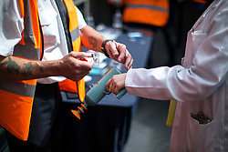 © Licensed to London News Pictures . 30/07/2017 . Manchester , UK . Visitors have their hands stamped for re-entry as they leave the venue . Cosplayers, families and guests at Comic Con at the Manchester Central Convention Centre . Photo credit : Joel Goodman/LNP