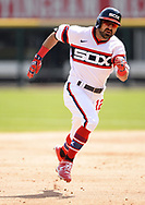 CHICAGO - APRIL 25:  Adam Eaton #12 of the Chicago White Sox heads toward third base while hitting a triple against the Texas Rangers on April 25, 2021 at Guaranteed Rate Field in Chicago, Illinois.  (Photo by Ron Vesely) Subject:  Adam Eaton