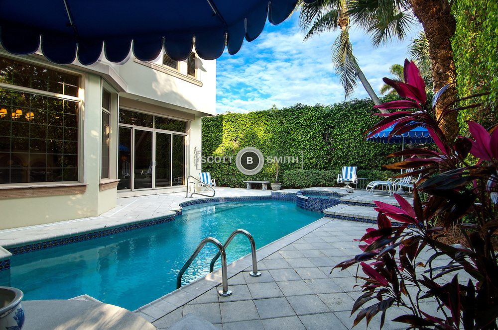 Real estate listing of luxury townhouse property in the mid-section of Palm Beach, Florida.