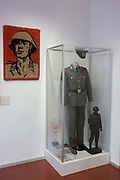 A soldier in uniform, an exhibit in 'Haus 1' the ministerial headquarters of the Stasi secret police in Communist East Germany, the GDR. Built in 1960, the complex now known as the Stasi Museum. Before the fall of the Wall, it was a 22-hectare complex of espionage whose centrepiece is the office and working quarters of the former Minister of State Security, Erich Mielke who considered their role as the 'shield and sword of the party', conducting one of the world's most efficient spying operations against its political dissenters during its 40-year old socialist history. Between 1950 and 1989, the Stasi employed a total of 274,000 people in an effort to root out the class enemy.