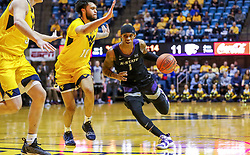 Feb 18, 2019; Morgantown, WV, USA; Kansas State Wildcats guard Shaun Neal-Williams (1) drives down the lane during the first half against the West Virginia Mountaineers at WVU Coliseum. Mandatory Credit: Ben Queen-USA TODAY Sports