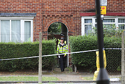 © Licensed to London News Pictures. 05/08/2019. London, UK. Police officers guard a house on Waltheof Gardens in Tottenham, north London. Police launch a murder investigation following a death of a woman at an address in Waltheof Gardens. Police were called around 10:45 am on 4 August 2019 where the body of an 89-year-old woman was found. According to the police one or more suspects gained entry to the woman's house between Saturday (3 August) evening and Sunday (4 August) morning. Photo credit: Dinendra Haria/LNP