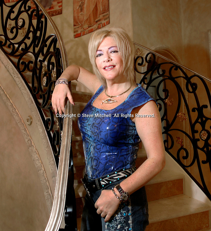 Professional interior designer Perla Lichi poses for a portrait on Saturday, May 19, 2007, in Parkland, Fla. (Photo by Steve Mitchell)