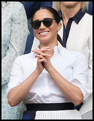 July 13, 2019 - London, London, United Kingdom - Meghan Markle, the Duchess of Sussex watches Serena Williams receive the runner up trophy after she lost  the Ladies Final on day twelve of the Wimbledon Tennis Championships in London. (Credit Image: © Stephen Lock/i-Images via ZUMA Press)