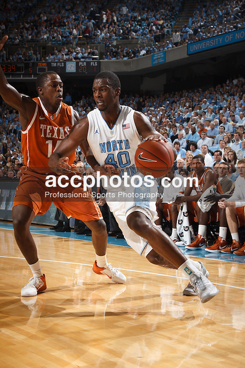 CHAPEL HILL, NC - DECEMBER 21: Harrison Barnes #40 of the North Carolina Tar Heels dribbles the ball around J'Covan Brown #14 of the Texas Longhorns on December 21, 2011 at the Dean E. Smith Center in Chapel Hill, North Carolina. North Carolina won 62-83. (Photo by Peyton Williams/UNC/Getty Images) *** Local Caption *** Harrison Barnes;J'Covan Brown