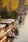 House boats at dawn are moored on the River Seine in Paris, France