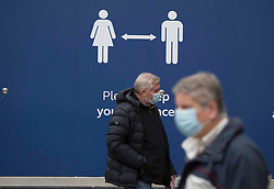 © Licensed to London News Pictures.13/12/2020. London, UK. Commuters in masks arrive in London Victoria Station. Health Secretary Matt Hancock says infections are starting to rise in some areas after falling during a four-week national lockdown in England that ended Dec. 2. Photo credit: Marcin Nowak/LNP