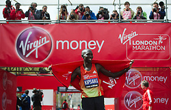 © London News Pictures. 22/04/2012. London, UK. Wilson Kipsang of Kenya celebrates winning the men's elite race during the 2012 Virgin London Marathon on April 22, 2012. Photo credit : Ben Cawthra /LNP