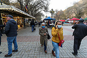 People, some of them wearing face surgical masks, walk across the Vernissage Market, in Yerevan, Armenia Capital city on Sunday, Dec 13, 2020. The country's economic power is draining after an armed conflict between Azerbaijan, supported by Turkey, and the self-proclaimed Republic of Artsakh together with Armenia, in the disputed region of Nagorno-Karabakh and surrounding territories started this year. (VXP Photo/ Vudi Xhymshiti)