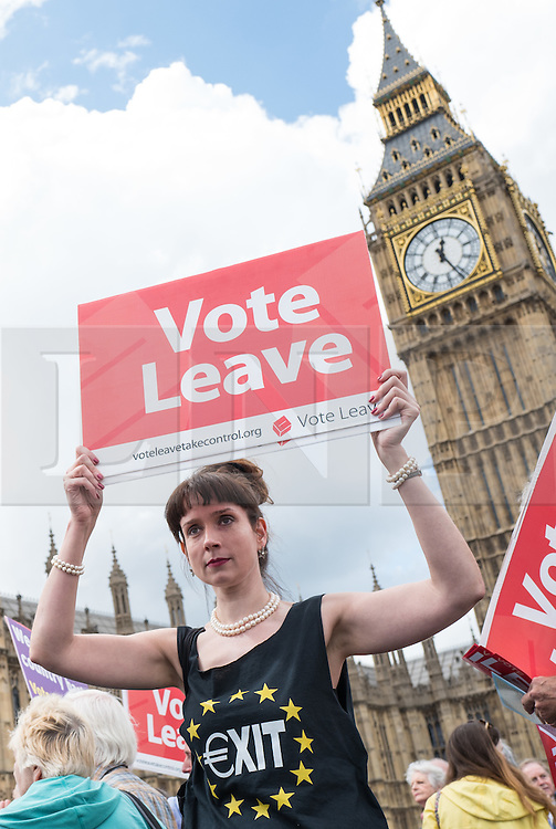 © Licensed to London News Pictures. 15/06/2016. London, UK. Pro-Brexit campaigners gather on Westminster Bridge for the arrival of a flotilla of fishing trawlers led by UKIP leader Nigel Farage. The flotilla is organised by the 'Fishing for Leave' campaign, founded by Scottish fisherman, which argues that the UK's fishing industry would be better off outside the EU, but with the same status as Iceland or Norway when fishing quotas are negotiated. Photo credit: Rob Pinney/LNP