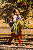 Tarahumara Indian women at the train station at San Rafael selling handwoven baskets, Copper Canyon, Mexico