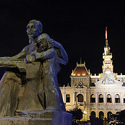"""At left is a statue of """"Uncle Ho,"""" while in the background is Ho Chi Minh City Hall. Ho Chi Minh City Hall was built in the early 20th Century by the French colonial government as Saigon's city hall. It's also known as Ho Chi Minh City People's Committee Head office, in French as Hôtel de Ville de Saigon, and in Vietnamese as Tr? s? ?y ban Nhân dân Thành ph? H? Chí Minh."""