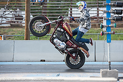 Stunting demo at the drag racing finals at the Stugis Dragway during the Annual Sturgis Black Hills Motorcycle Rally. Sturgis, SD, USA. Monday August 7, 2017. Photography ©2017 Michael Lichter.
