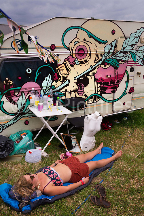 Glastonbury Festival, 2015.<br /> Sleeping in front of a caravan after a long night