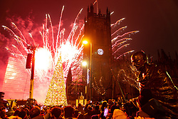 © Licensed to London News Pictures . 01/01/2020. Manchester, UK. Thousands watch a fireworks display in from of Manchester Cathedral as Manchester celebrates the start of 2020 . Photo credit: Joel Goodman/LNP