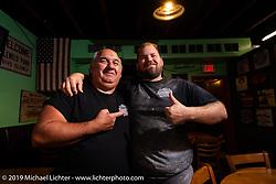 A happy father and Son - Big Joe and Little Joe Mialki at their South Daytona Beach Giuseppe's Steel City Pizza restaurant during Daytona Bike Week. FL. USA. Monday March 12, 2018. Photography ©2018 Michael Lichter.