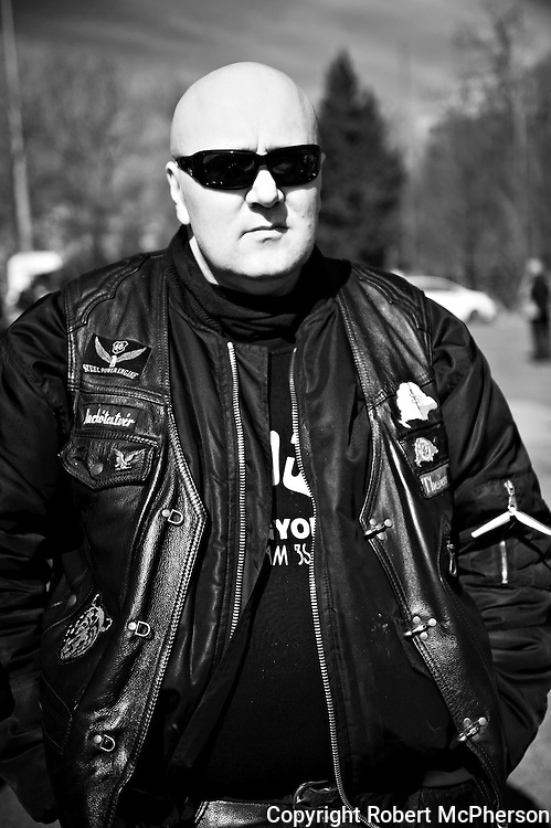 """On image Verèb Jòzsef. Member of the right-wing extremist group Gòj Motorosok in Hungary.<br /> <br /> They are a smaller organization than """"The Hungarian Guard"""" and operate with low profile. However, they have taken over the leadership in one of the theatres in Budapest. They are not associated with any government party in Hungary. On one of the national days in Hungary in March 2012, they had their own """"parade"""" riding their motorbikes around in the city of Budapest. They claimed themselves that they did not do this to get public attention. The photographer got the oppurtunity to meet them over a very short period of time privat."""