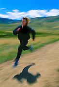 Deena Drossin, U.S. long-distance runner on path near Boulder, Colorado.  She has won many national championship including the New York City Marathon.