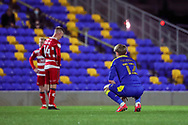 AFC Wimbledon midfielder Jack Rudoni (12) keeling down during the EFL Sky Bet League 1 match between AFC Wimbledon and Doncaster Rovers at Plough Lane, London, United Kingdom on 3 November 2020. The first League match at the new stadium.