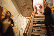 The stairs with pinups paintings at Pensão Amor, a former pension that is now a bar with art performances, erotic bookshop and rooms for renting to artistic entrepreneurs.