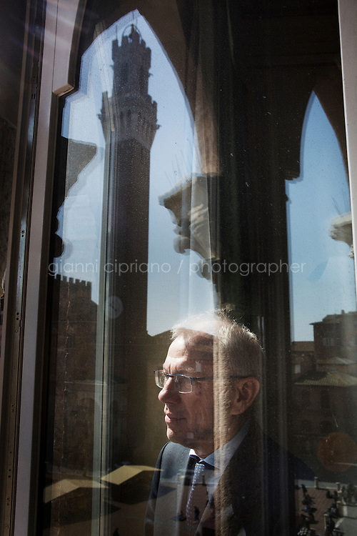 SIENA, ITALY - 20 MARCH 2015:  Marcello Clarich (57), President of the Monte dei Paschi di Siena Foundation, poses for a portrait at Palazzo Sansedoni (headquarters of the foundation) in Siena, Italy, on March 20th 2015. <br /> <br /> The charitable Monte dei Paschi di Siena Foundation is the bank's largest shareholder that has financed projects in the fields of economic development, art and research. Until 2014, the Foundation has entirely funded Siena Biotech, a clinical-stage drug discovery company whose  efforts are mainly focused on discovering new drugs for therapeutic intervention against neurodegenerative diseases and in oncology, such as Alzheimer's Disease, Huntington's Disease and Cancer.<br /> <br /> Now Siena Biotech has filed for bankruptcy proceedings, and its researchers and employees occupied the headquarters of the company based in Siena.<br /> <br /> Siena, a Tuscan city and UNESCO World Heritage Site, is home to Monte dei Paschi di Siena, the world's oldest surviving bank and Italy's third largest bank. The bank, founded in 1472, was the largest employer in Siena, and it helped finance a host of community projects and services until it stumbled during the financial crisis started in 2008.