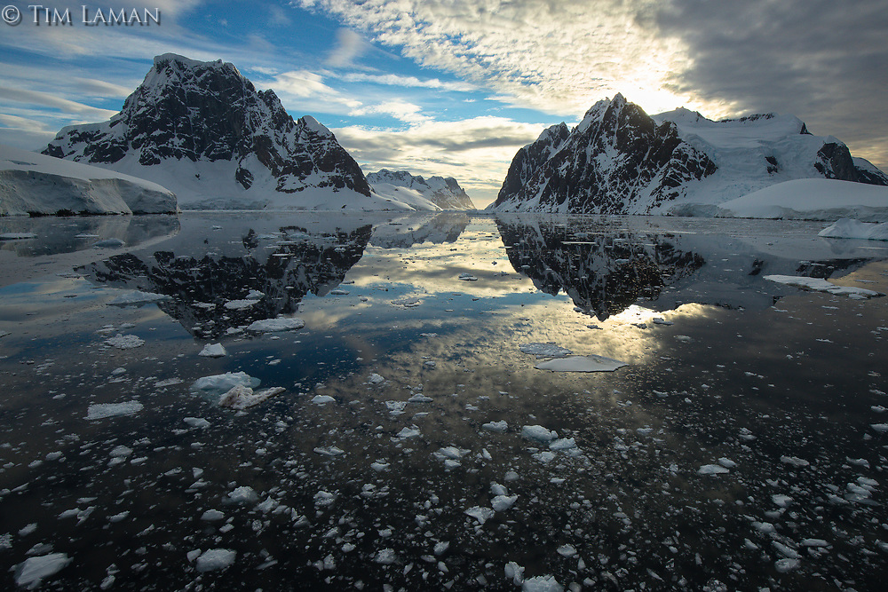 Perfect reflections amid brash ice in the Lemaire Channel, Antarctica.