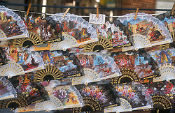 Display of fans depicting scenes of bullfights and flamenco dancing,