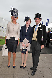 The EARL & COUNTESS OF DERBY with their daughter LADY HENRIETTA STANLEY at the 2012 Investec sponsored Derby at Epsom Racecourse, Epsom, Surrey on 2nd June 2012.