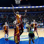 Fenerbahce's Cappie Pondexter (R) and Galatasaray's Sylvia Fowles (C) during their Turkish Basketball woman league derby match Fenerbahce between Galatasaray at Ulker Sports Arena in Istanbul, Turkey, wednesday, December 26, 2012. Photo by Aykut AKICI/TURKPIX