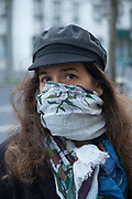 """March, 22nd 2020 - Paris, Ile-de-France, France: Parisians wearing a range of masks and facial coverings in the hope of protecting themselves from the spread of the Coronavirus, during the sixth day of near total lockdown imposed in France. Almost a week after President of France, Emmanuel Macron, said the citizens must stay at home from midday on Tuesday for at least 15 days. He said """"We are at war, a public health war, certainly but we are at war, against an invisible and elusive enemy"""". All journeys outside the home unless justified for essential professional or health reasons are outlawed. Anyone flouting the new regulations would be punished. Nigel Dickinson"""