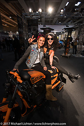 Kia Niedrich of Easyriders Germany and Simone Messer of Custom Chrome Europe in the CCE booth at Motor Bike Expo. Verona, Italy. Sunday January 22, 2017. Photography ©2017 Michael Lichter.