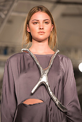 © Licensed to London News Pictures. 31/05/2014. London, England. Collection by Holly Glover from Edinburgh College of Art. Graduate Fashion Week 2014, Runway Show at the Old Truman Brewery in London, United Kingdom. Photo credit: Bettina Strenske/LNP