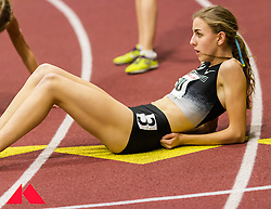 Womens Invitational Mile at BU Terrier Indoor Track, Mary Cain lays on track after winning race