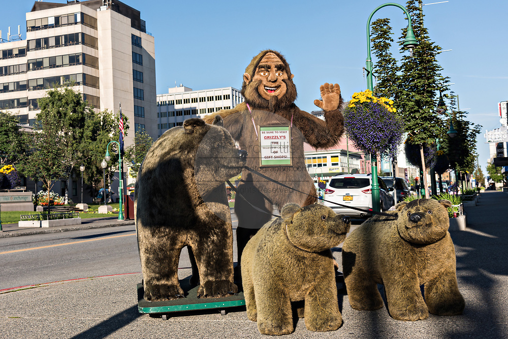 A display of giant stuffed bears and Bigfoot outside a tourist shop along 4th Avenue in downtown Anchorage, Alaska.