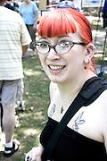 Woman age 26 with red hair enjoying the festival. Svenskarnas Dag Swedish Heritage Day Minnehaha Park Minneapolis Minnesota USA
