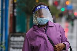 © Licensed to London News Pictures. 20/01/2021. London, UK. A woman wearing a visor and a protective face covering in north London, after the mutated variant of the SARS-Cov-2 virus continues to spread around the country. On Tuesday 19 January, 1,610 people died in the UK within 28 days of a positive Covid-19 test. This is the biggest figure reported in a single day in the UK since the pandemic began last year. According to government figures over 4.2 million people have now received the first dose of a vaccine. Photo credit: Dinendra Haria/LNP