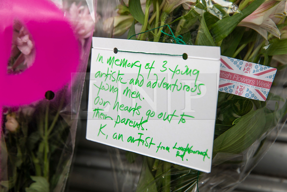 © Licensed to London News Pictures. 19/06/2018. London, UK. A hand-written note from a local artist is left with flowers outside Loughborough Junction station as a tribute for the three graffiti artists believed to have been killed by a night train. Photo credit: Rob Pinney/LNP