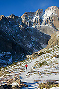 Clare Gallagher out for a winter training run in the front range of Colorado, up to Chasm Lake. Mission Tights, Houdini, Capilene Air, Micro Puff Hoodie, Nano Air Light Hybrid