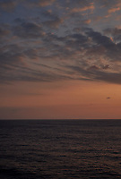 Orange colored sky and clouds over the Pacific Ocean just after sunrise. Image 1 of 10 for a wide-angle panorama taken with a Fuji X-T1 camera and 35 mm f/1.4 lens  (ISO 200, 35 mm, f/16, 1/250 sec). Raw images processed with Capture One Pro and stitched together with AutoPano Giga Pro.
