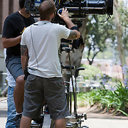 Camera operators with movie camera on set.