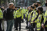 """Photographer takes a headshot of protesters chained in front of the Home Office at the """"Climate Justice is Migrant Justice"""",outside Home Office, Marsham Street in central London on Friday, Sept 4, 2020. (VXP Photo/ Gio Strondl)"""
