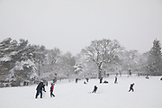 People and families in Kings Heath Park head out to enjoy the heavy snow fall on Sunday 10th December 2017 in Birmingham, United Kingdom. Deep snow arrived in much of the UK, closing roads and making driving treacherous, while many people simply enjoyed the weather.