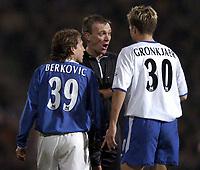 Photo: Richard Lane.<br /> Portsmouth v Chelsea. Barclaycard Premiership.<br /> 11/02/2004.<br /> Graham Poll sorts a dispute between Eyal Berkovic and Jesper Gronkjaer.