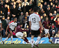 Photo: Lee Earle.<br /> Fulham v Arsenal. The Barclays Premiership. 04/03/2006. Arsenal's Francesc Fabregas (2ndL) scores their fourth goal.