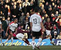 Photo: Lee Earle.<br /> Fulham v Arsenal. The Barclays Premiership. 04/03/2006. Arsenal's Francesc Fabregas (2ndL) scores their fourth goal.