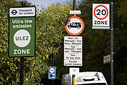 Transport for Londons TFL new signposts for the new Ultra Low Emissions Zone ULEZ have been erected around the inner orbital road perimeter around the capital, and seen on the South Circular in East Dulwich on the day that the new area becomes effective for newer vehicles, on 25th October 2021, in London, England. Now 18 times larger, the new ULEZ area bans older vehicles such as polluting diesels and petrol cars older than 2006, an attempt to lower poisonous emissions that further harm the health of 1 in 10 children who have asthma. Drivers of non-exempt vehicles may enter the ULEZ after paying a £12.50 daily fee - or face a £160 penalty.