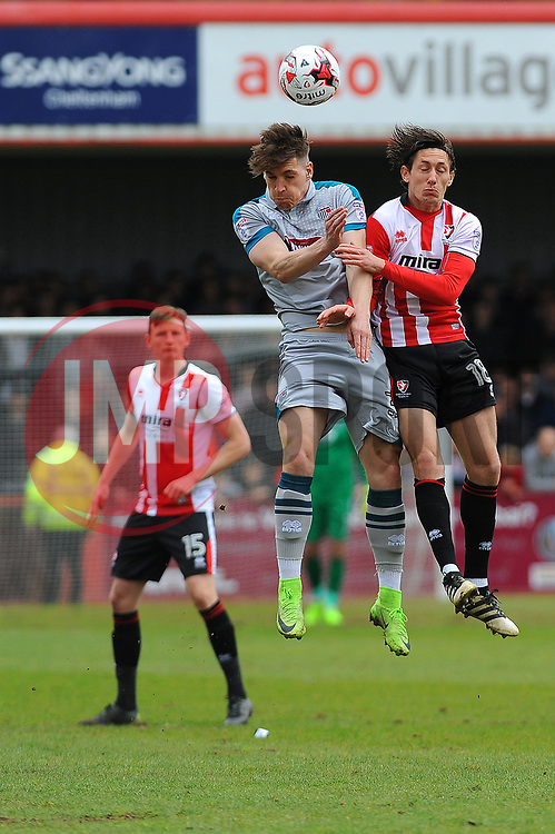 Sam Jones of Grimsby Town competes with James Rowe of Cheltenham Town for the high ball - Mandatory by-line: Nizaam Jones/JMP - 17/04/2017 - FOOTBALL - LCI Rail Stadium - Cheltenham, England - Cheltenham Town v Grimsby Town - Sky Bet League Two