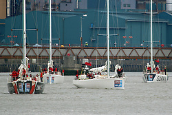 © Licensed to London News Pictures. 20/08/2015.  The yachts have arrived in London for the next edition of the Clipper Round The World race. The clipper yachts were pictured passing the Thames Barrier in south east London as they made their up the river. They will be moored at St Katherine Docks until the start of the round the world race on August 30th. Ordinary members of the public crew the yachts under the captaincy of professional skippers. Credit : Rob Powell/LNP